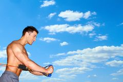 Exercising over sky background Stock Photos