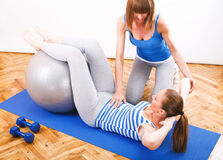 Exercising With a Personal Trainer Royalty Free Stock Images