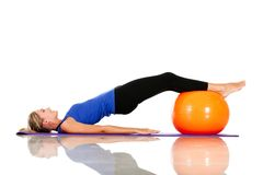 Exercising with pilates ball Royalty Free Stock Photo