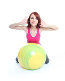 Exercising with a pilates ball Royalty Free Stock Images
