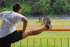 Exercising and running. People doing exercise and running in the stadium stock photo