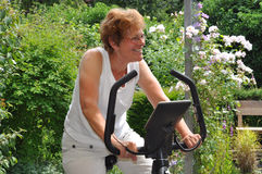exercising senior woman Royaltyfri Bild