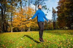 Exercising with skipping rope Stock Photography