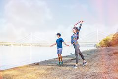 Exercising- Sports couple training outdoors -Woman working out with resistance bands stock image