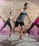 Exercising with stretching band Stock Photo