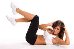 Exercising Teenager. A beautiful teenager exercising to remain fit, on white studio background Stock Photo