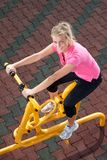 Exercising time. Girl exercising on stepper machine - looking happy Royalty Free Stock Photos