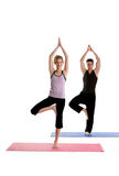 Exercising Together. Cute Couple Doing Yoga on a white background Stock Photo