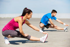 Exercising together is fun. Stock Images