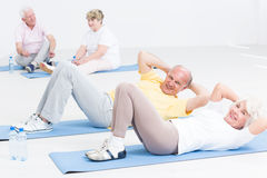 Exercising together gives them lots of fun in old age Stock Image
