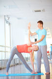 Exercising with trainer stock photography