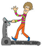 Exercising with Treadmill. A man using treadmill and smiling Royalty Free Stock Photos