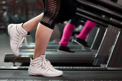 Exercising on treadmill, close-up of legs Stock Image