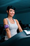 Exercising with treadmill at gym Stock Images