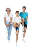 Exercising with two boys Stock Image