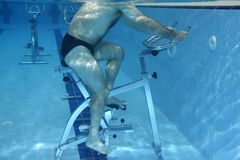 Exercising underwater. Underwater picture - man exercising on a Bicycle Royalty Free Stock Photography