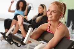 Exercising on weight machine Stock Images