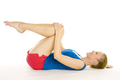Exercising woman. Lying on the floor Royalty Free Stock Images