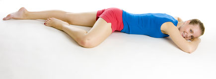 Exercising woman. Lying on the floor Stock Images