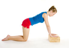 Exercising woman. Kneeling on the floor Royalty Free Stock Photo