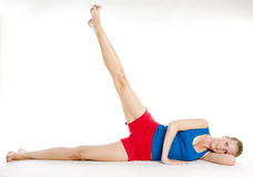 Exercising woman. Lying on the floor Royalty Free Stock Photos