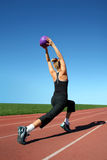 Exercising woman. Young pretty woman exercising on a racetrack Stock Photo