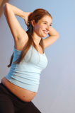 Exercising woman Stock Images