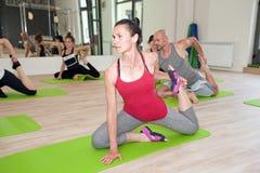 Exercising yoga Stock Images