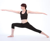 Exercising Yoga Warrior Two pose Virabhadrasana Stock Photos