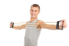 Exercising young man with expander Royalty Free Stock Photos
