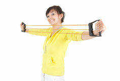Exercising young woman with expander Royalty Free Stock Photos
