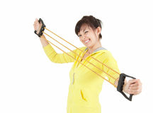 Exercising young woman with expander Stock Images