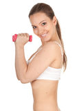 Exercising young woman and fitness weights Royalty Free Stock Images