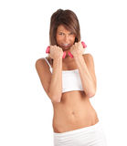 Exercising young woman with fitness weights Royalty Free Stock Images