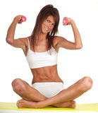 Exercising young woman with fitness weights Stock Photo