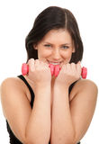 Exercising young woman with pink fitness weights Royalty Free Stock Image