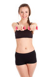 Exercising young woman with pink fitness weights Stock Photo