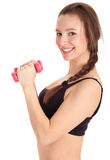 Exercising young woman with pink fitness weights Stock Photos