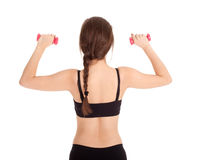 Exercising young woman with pink fitness weights Stock Image