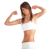 Exercising young woman with pink fitness weights Royalty Free Stock Photo