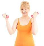 Exercising young woman with small dumbbells Stock Image