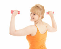 Exercising young woman with small dumbbells Stock Photo
