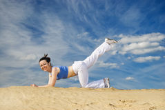 Exersice on a sand Royalty Free Stock Images