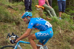 The exertion on the face. A cyclist is is climbing the first kilometers of the Zoncolan slope during the last Giro d'Italia 2010 race (lap 15 on 23 of May). The Stock Photos