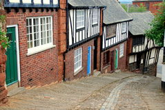 Exeter, England: Stepcote Hill. Charming brick and half-timbered houses dating to the 17th century line Stepcote Hill with its cobblestone street in Exeter Stock Images