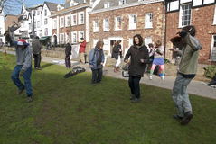 Exeter Occupy activists dance on Cathedral green Royalty Free Stock Photo