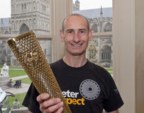 Exeter Olympic Torchbear Paul Giblin Stock Photos