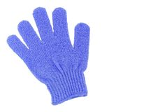Exfoliating glove. Beautiful pale blue exfoliating glove. Isolated on white Royalty Free Stock Images