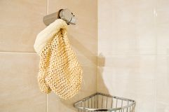 Exfoliating mitt in the shower. Exfoliating glove hanging on shower at the bathroom with copyspace Royalty Free Stock Photography