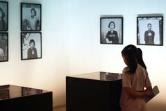 Exhabition. A asia girl go to see the exhibition Royalty Free Stock Photos